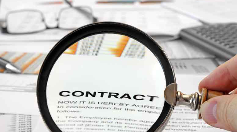 Magnifying-Glass-Over-Contract-Papers-000028250286_Large.jpg