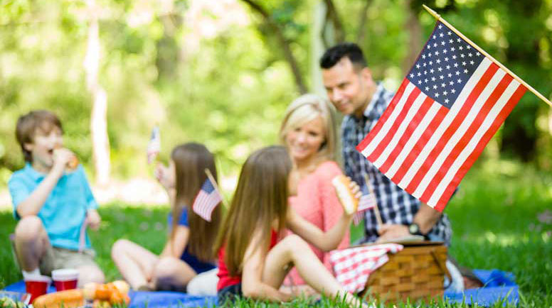 Family-enjoys-July-4th-picnic-in-summer-season.jpg