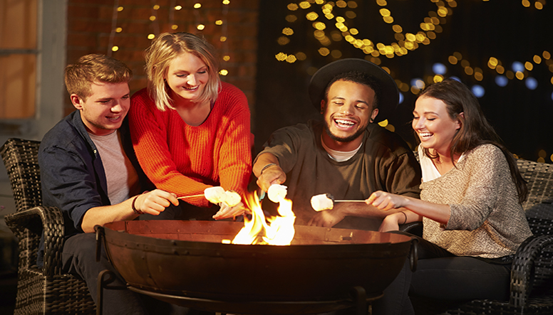 Group-Of-Friends-Toasting-Marshmallows-By-Firepit-resized.jpg