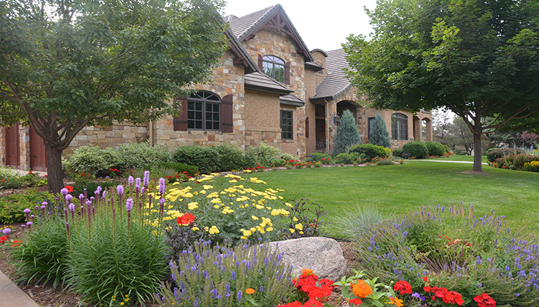 nice house with pretty lawn and landscape Credit Timberline Landscaping,.JPG